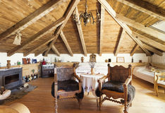 Interior of a rustic room in the attic Royalty Free Stock Photo