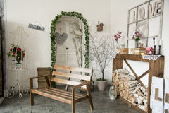 Interior rustic room with bench and firewood woodpile Stock Photos