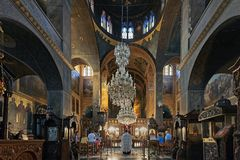 Interior of the Saint Marina Orthodox Church in Athens, Greece. The evening service in the Saint Marina Orthodox Church in Athens, Greece royalty free stock photos