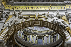 Interior of Saint Peter`s Basilica, closeup of arch figures. A close up of an arch in the interior of Saint Peter`s Basilica in Vatican City, Rome.  A male and Stock Photo