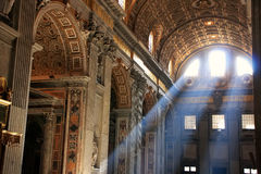 Interior of Saint Peters Basilica with crepuscular rays Royalty Free Stock Image