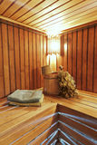 The interior of the sauna - bench, lamp, Royalty Free Stock Photography