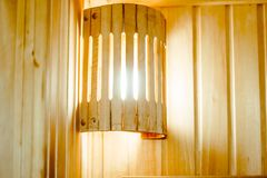 Wooden shelves in the sauna. The interior of the sauna - shelves, window, lamp, nobody Stock Images
