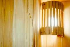 Wooden shelves in the sauna. The interior of the sauna - shelves, window, lamp, nobody Royalty Free Stock Image