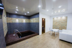 Interior of sauna with a swimming pool. And a place to relax Royalty Free Stock Images