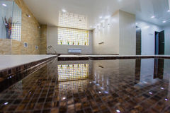 Interior of sauna with a swimming pool. And a place to relax Royalty Free Stock Photo