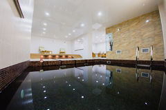 Interior of sauna with a swimming pool. And a place to relax Royalty Free Stock Photos