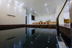 Interior of sauna with a swimming pool. And a place to relax Stock Photography