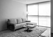 Interior scene. Sofa under the window light. Black and White. Stock Photography