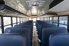 Inside the School Bus. Interior of school bus with empty seats royalty free stock photos