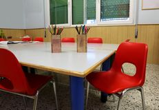 Interior of a school classroom of a school with red chairs and p royalty free stock photos