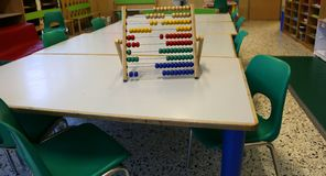 Interior of a school classroom with wooden abacus above the tabl royalty free stock image