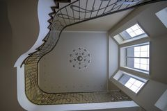 The interior of the second light stairs, railings chandelier royalty free stock photo