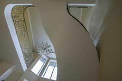 The interior of the second light stairs, railings chandelier stock photography
