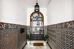 Interior in Sevilla, Spain. Entrance decorated with a mosaic pattern royalty free stock photos