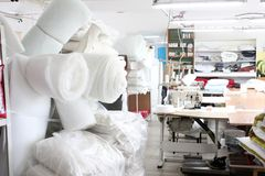 The interior of the sewing factory shop. Closed Studio with several sewing machines. Garment industry. Blurred photo for backgroun