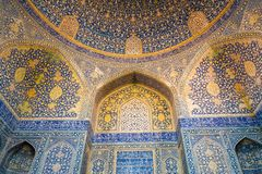 Interior of Shah mosque. Beautiful dome and vaulting with Islamic arabesque pattern covered with mosaic tiles. Isfahan, Iran. stock photography