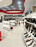 Interior of shoe shop. Interior of shop of fashionable footwear Stock Photo