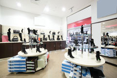 Interior of shoe store in modern european mall Royalty Free Stock Photos