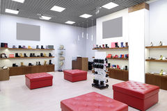 Interior of shoe store in modern european mall Royalty Free Stock Image