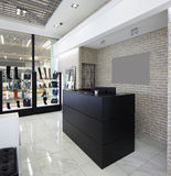 Interior of shoe store in modern european mall. Bright and fashionable interior of shoe store in modern mall Royalty Free Stock Photo