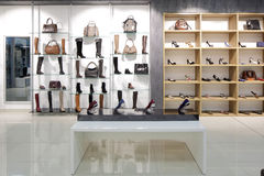 Interior of shoe store in modern european mall. Bright and fashionable interior of shoe store in modern mall Stock Images