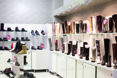 Interior of shoe store in modern european mall Royalty Free Stock Images