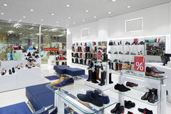 Interior of shoe store in modern european mall. Bright and fashionable interior of shoe store in modern mall Stock Photos
