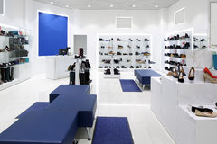 Interior of shoe store in modern european mall. Bright and fashionable interior of shoe store in modern mall Royalty Free Stock Photography
