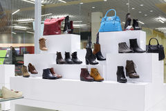 Interior of shoe store in modern european mall. Bright and fashionable interior of shoe store in modern mall Stock Photo