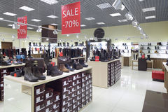 Interior of shoe store in modern european mall. Bright and fashionable interior of shoe store in modern mall Stock Image