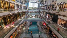 Interior of The Shoppes at Marina Bay Sands timelapse.