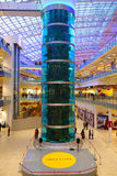 Interior of a shopping complex. Hall store.a large aquarium with exotic fish Stock Image