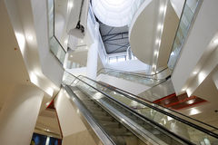 Interior of shopping mall. Bright interior of empty shopping mall with multilevel escalators Stock Photo