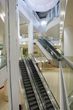 Interior of shopping mall. Bright interior of empty shopping mall with multilevel escalators stock photography