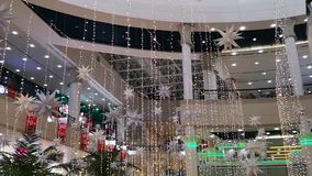Interior shopping mall decorations with lights and stars celebrating festivals - Al Wahda Mall, Abu Dhabi.  stock video footage
