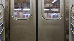 Interior Shot of Closed New York City Subway Doors as Car Approaches Platform. 7982 An interior shot of closed New York City subway doors as the car approaches stock footage
