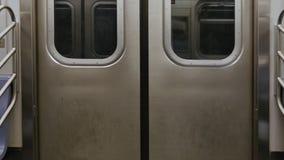 New York City Subway Interior Doors While Traveling. 7981 An interior shot of closed New York City subway doors while traveling stock video footage