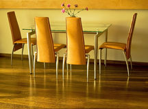 Interior shot of dining area. Dining table  with orange chairs Stock Image