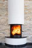 An interior shot of a modern marble fireplace Royalty Free Stock Image