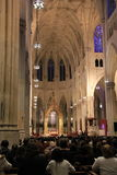 Interior shot of people praying during services, St Patrick's Cathedral, NYC,2015 Royalty Free Stock Photos