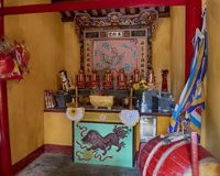 Interior of small Buddhist temple in Hoi An, Vietnam dedicated to easing the pain of Agent Orange royalty free stock photography