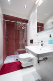 Interior of a small red white bathroom Royalty Free Stock Photos