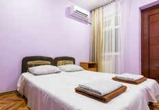 Interior of a small room with a double bed, a window and splitsistema Royalty Free Stock Photo
