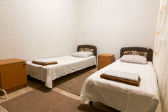 Interior of a small room with two beds Stock Images