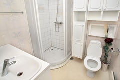 Interior of small white bathroom Stock Photos