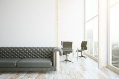 Interior with sofa and blank wall Stock Photos