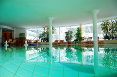 Interior of a spa hotel. With turquoise water in the swimming pool royalty free stock photos