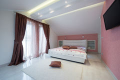 Interior of a specious bedroom Stock Photography