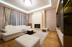 Interior of a specious living room with fireplace Stock Photos
